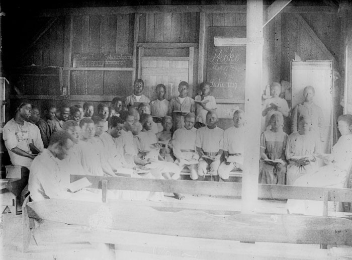 Reading class of Lena Clark Whitman, 1895 graduate in missionary training at Spelman, Ikoko, the Congo, c. 1900<br />
