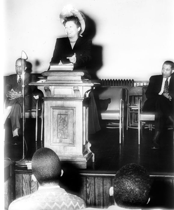 Toki Schalk Johnson, Women's Editor, Pittsburg Courier, at Morehouse Institute on Successful Marriage and Family Living; Walter R. Chivers, left, Chair of Sociology Department and founder of Institute; Samuel Williams, Professor of Religion, 1948.<br />