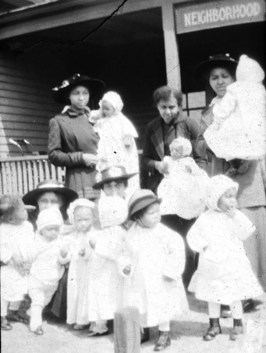 Women attend children at Neighborhood Union, a social service agency, c. 1910.<br />
