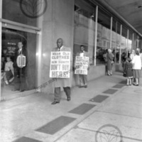 John Calhoun and Jesse Hill walking picket line<br />