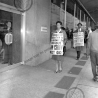 Johnny Yancey and M. Carl Holman walking picket line at Rich's Department Store
