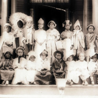 Clark kindergarten students on steps of Thayer Home, c. 1920s<br />