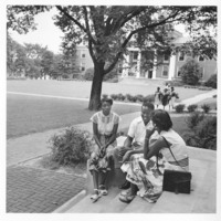 Three Unidentified Students Outside of Campus Building