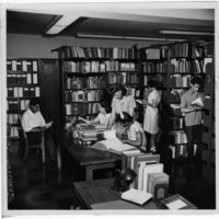 Eileen Bentley in the Library with Students