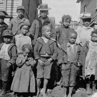 Mary Ann Brooks, back row center, who was a student in the primary department of Spelman in the morning, taught these neighborhood children in the afternoon<br />