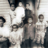 Janitor of Spelman, far right front, and his family, c. 1905.<br />