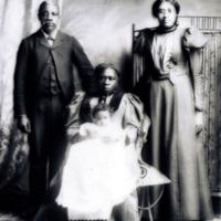 Family of Spelman graduate, Hattie Bryant, standing, c. 1900<br />