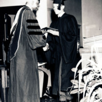 Dr. Benjamin E. Mays, President of Morehouse from 1940 to 1967 presenting diploma to Harold Randolph, 1953.<br />