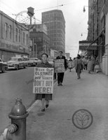 AI_045_19600000_Woman marching_webwm.jpg